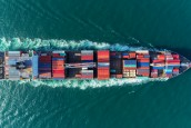 Aerial view Top speed with beautiful wave of container ship full load container with crane loading container for logistics import  export or transportation concept background.