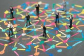 Diversify people or social network concept, miniature people businessmen standing on colorful pastel chalk line link and connect between multiple dot or peer on blackboard